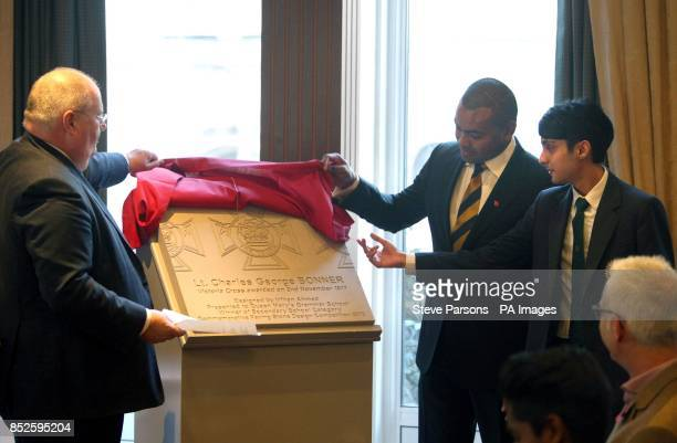 Eric Pickles Johnson Beharry with secondary school winner Irfhan Ahmed unveil a paving stone at the Army and Navy Club in Central London which will...