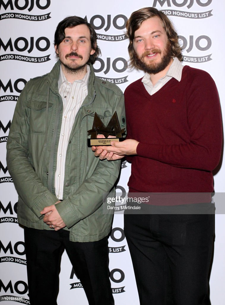 Eric Pulido (R) and Paul Alexander of Midlake with an award at The Mojo Honours List at The Brewery on June 10, 2010 in London, England.