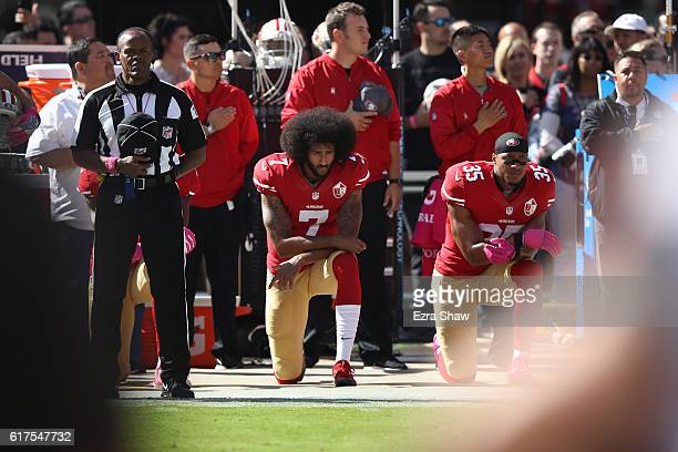 Eric Reid and Colin Kaepernick of the San Francisco 49ers kneel in protest during the national anthem prior to their NFL game against the Tampa Bay...