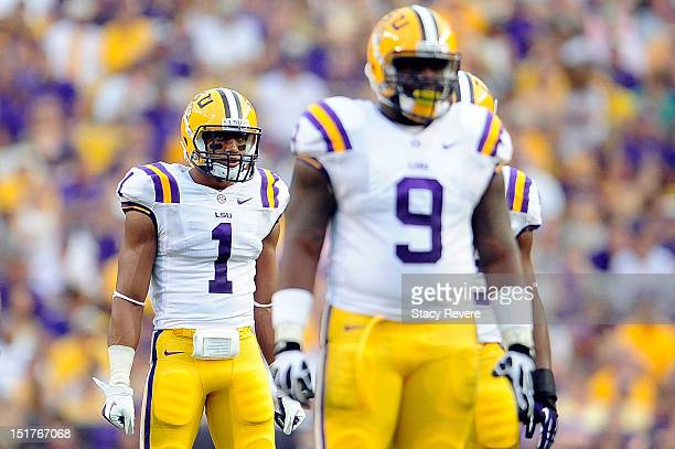 Eric Reid and Ego Ferguson of the LSU Tigers prepare for action during a game against the Washington Huskies at Tiger Stadium on September 8 2012 in...