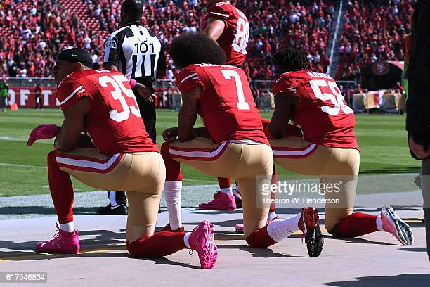 Eric Reid Colin Kaepernick and Eli Harold of the San Francisco 49ers kneel in protest during the national anthem prior to their NFL game against the...