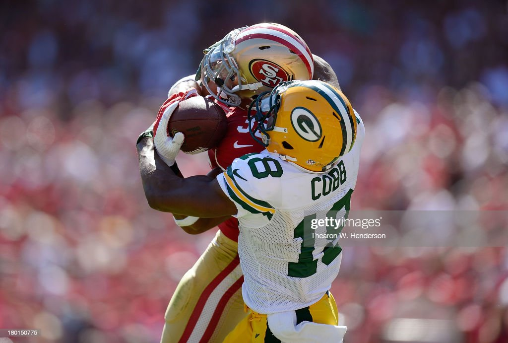 Eric Reid #35 of the San Francisco 49ers intercepts this pass over Randall Cobb #18 of the Green Bay Packers but the play was called back due to an offside penalty against the 49ers during the second quarter at Candlestick Park on September 8, 2013 in San Francisco, California.