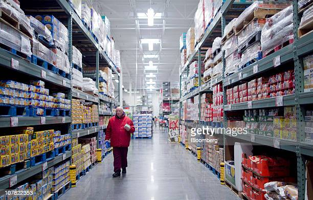 Eric Rodenhauser shops inside a BJ's Wholesale Club store in Falls Church Virginia US on Thursday Dec 30 2010 BJ's Wholesale Club Inc rose 71 percent...