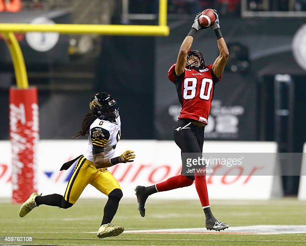 Eric Rogers of the Calgary Stampeders makes a reception in front of Rico Murray of the Hamilton TigerCats during the 102nd Grey Cup Championship Game...