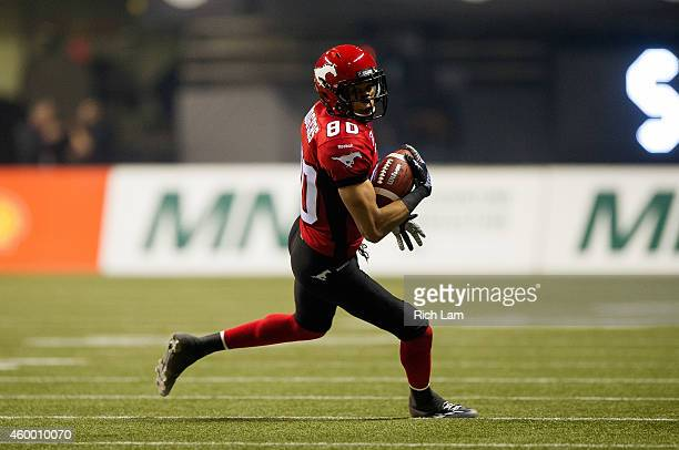 Eric Rogers of the Calgary Stampeders runs with the ball during the 102nd Grey Cup Championship Game against the Hamilton TigerCats at BC Place...