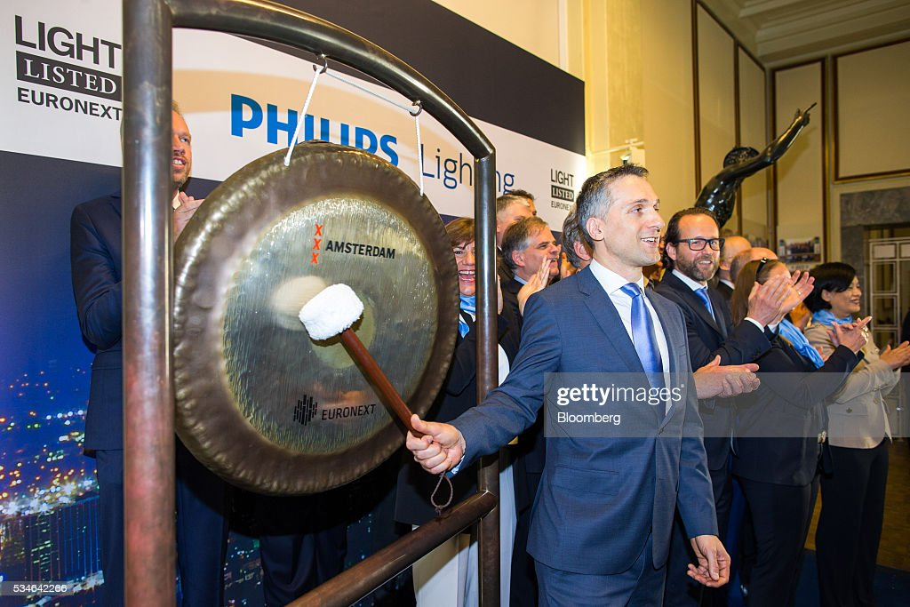 Eric Rondolat, chief executive officer of Philips Lighting NV, bangs a gong to indicate the start of trading at Amsterdam Stock Exchange (AEX), operated by Euronext NV, in Amsterdam, Netherlands, on Friday, May 27, 2016. Philips Lighting NV shares jumped in their trading debut after Dutch parent company Royal Philips NV raised 750 million euros ($839 million) in an initial public offering of the worlds biggest general luminaries business. Photographer: Jasper Juinen/Bloomberg via Getty Images