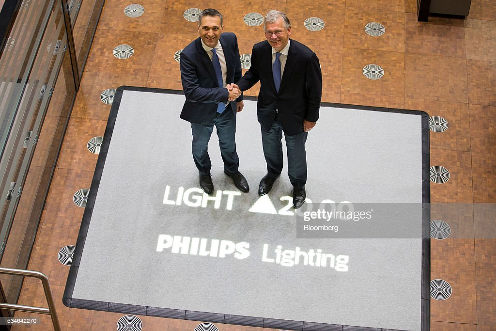 Eric Rondolat, chief executive officer of Philips Lighting NV, left, and Frans van Houten, chief executive officer of Royal Philips NV, pose for a photograph ahead of the start of trading at Amsterdam Stock Exchange (AEX), operated by Euronext NV, in Amsterdam, Netherlands, on Friday, May 27, 2016. Philips Lighting NV shares jumped in their trading debut after Dutch parent company Royal Philips NV raised 750 million euros ($839 million) in an initial public offering of the worlds biggest general luminaries business. Photographer: Jasper Juinen/Bloomberg via Getty Images