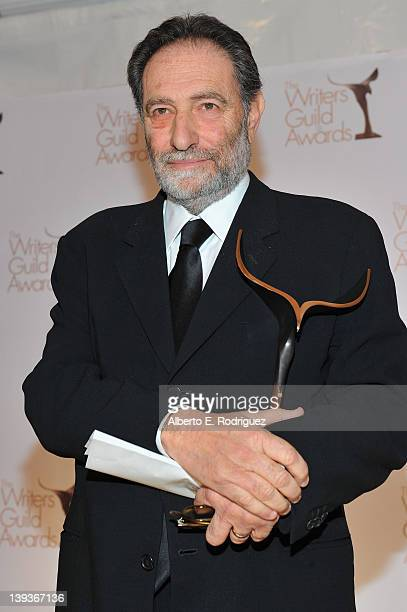 Eric Roth poses with the 2012 Screen Laurel Award in the press room during the 2012 Writers Guild Awards at the Hollywood Palladium on February 19...