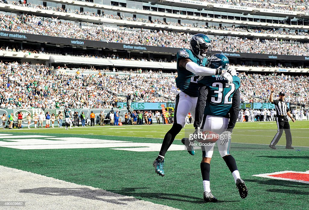 Eric Rowe celebrates with Malcolm Jenkins of the Philadelphia Eagles after intercepting a pass in the third quarter against the New York Jets at...