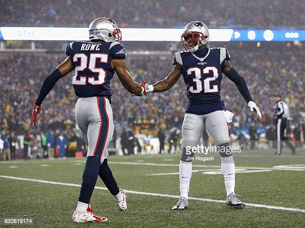 Eric Rowe of the New England Patriots reacts with Devin McCourty against the Pittsburgh Steelers in the AFC Championship Game at Gillette Stadium on...