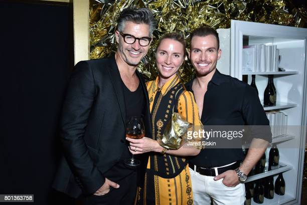 Eric Rutherford Alex Daily and Guest attend The Dom Perignon Vintage Trinity Launch Party at 17 Irving Place on June 22 2017 in New York City