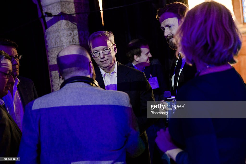 <a gi-track='captionPersonalityLinkClicked' href=/galleries/search?phrase=Eric+Schmidt&family=editorial&specificpeople=5515021 ng-click='$event.stopPropagation()'>Eric Schmidt</a>, chairman of Alphabet Inc., center, looks on before speaking during the opening of 'Startup Fest', a five-day conference to showcase Dutch innovation, in Amsterdam, Netherlands, on Tuesday, May 24, 2016. The Digital City Index for 2015 ranked Amsterdam Europe's second-best city, behind London, for tech startups. Photographer: Marlene Awaad/Bloomberg via Getty Images