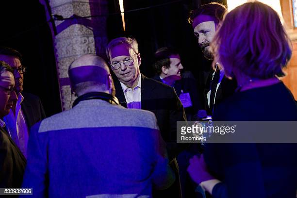 Eric Schmidt chairman of Alphabet Inc center looks on before speaking during the opening of 'Startup Fest' a fiveday conference to showcase Dutch...
