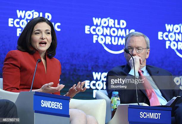 Eric Schmidt chairman of Google Inc right listens as Sheryl Sandberg billionaire and chief operating officer of Facebook Inc speaks during a session...