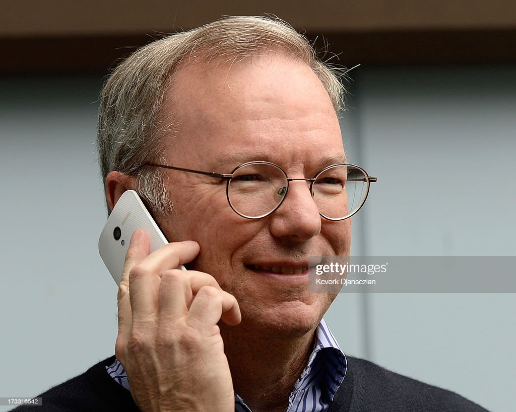 Eric Schmidt, executive chairman of Google, makes a call on still to be released Google produced Moto X phone during the Allen & Co. annual conference on July 11, 2013 in Sun Valley, Idaho. The resort will host corporate leaders for the 31st annual Allen & Co. media and technology conference where some of the wealthiest and most powerful executives in media, finance, politics and tech gather for a weeklong meetings which begins Tuesday. Past attendees included Warren Buffett, Bill Gates and Mark Zuckerberg.