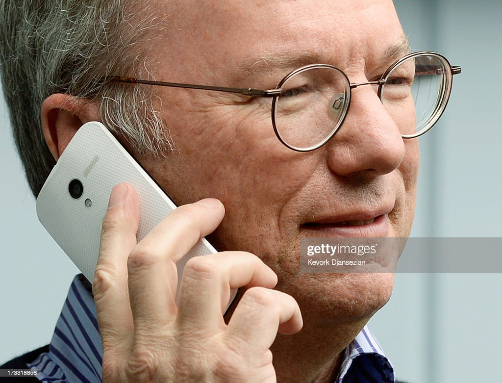 Eric Schmidt, executive chairman of Google, makes a call on the still to be released Google produced Moto X phone during the Allen & Co. annual conference on July 11, 2013 in Sun Valley, Idaho. The resort will host corporate leaders for the 31st annual Allen & Co. media and technology conference where some of the wealthiest and most powerful executives in media, finance, politics and tech gather for a weeklong meetings which begins Tuesday. Past attendees included Warren Buffett, Bill Gates and Mark Zuckerberg.