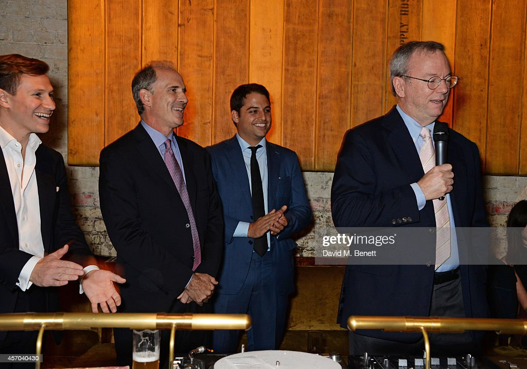 Eric Schmidt speaks as Dave Clark Jonathan Rosenberg and Jamie Reuben listen at the book launch party for 'How Google Works' by Eric Schmidt and...