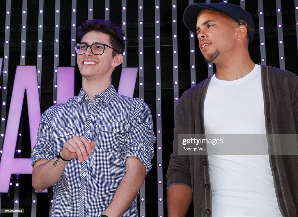Eric Secharia (L) and Joey Diggs Jr. of Midnight Red perform at Universal CityWalk 20th Anniversary event featuring 8 original cars from 'Fast & The Furious' Movie Franchise at 5 Towers Outdoor Concert Arena on May 23, 2013 in Universal City, California.