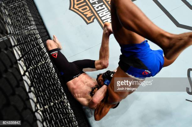 Eric Shelton flips over Jarred Brooks in their bantamweight bout during the UFC 214 event at Honda Center on July 29 2017 in Anaheim California