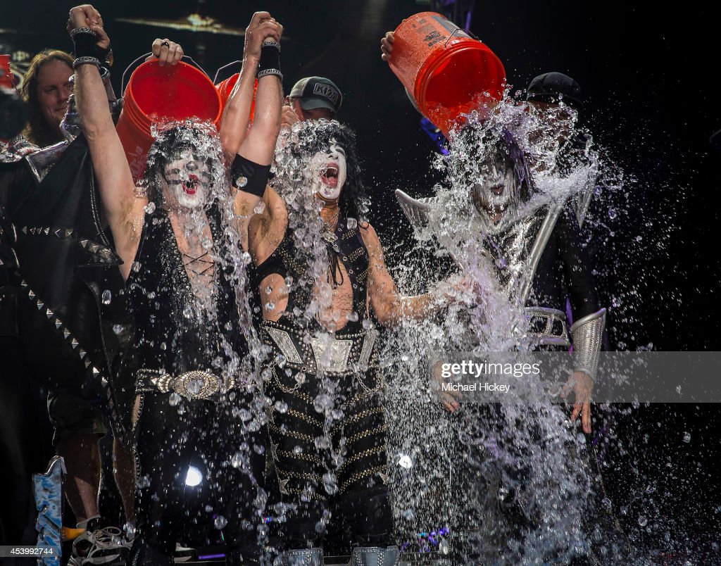 Eric Singer Paul Stanley and Tommy Thayer of the band KISS participates in the ALS Ice Bucket Challenge at Klipsch Music Center on August 22 2014 in...