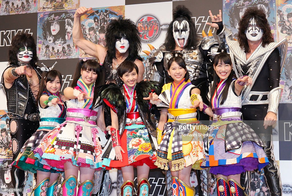 Eric Singer, Paul Stanley, Gene Simmons and Tommy Thayer of rock band KISS and Japanese idol group Momoiro Clover Z pose during their Japan tour press conference on February 21, 2015 in Tokyo, Japan.