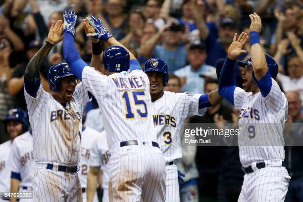 Eric Sogard Neil Walker Orlando Arcia and Manny Pina of the Milwaukee Brewers celebrate after Walker hit a grand slam in the eighth inning against...