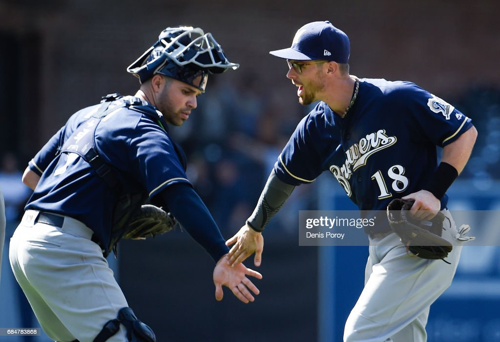 Eric Sogard #18 of the Milwaukee Brewers celebrates with Manny Pina #9 after defeating the San Diego Padres 4-2 in a baseball game at PETCO Park on May 18, 2017 in San Diego, California. The Brewers won 4-2.
