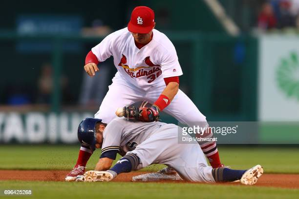 Eric Sogard of the Milwaukee Brewers slides safely into second base against Aledmys Diaz of the St Louis Cardinals for a double in the fifth inning...