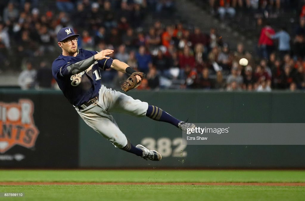 Eric Sogard #18 of the Milwaukee Brewers tries unsuccessfully to throw Gorkys Hernandez #66 of the San Francisco Giants out at first base in the second inning at AT&T Park on August 22, 2017 in San Francisco, California.