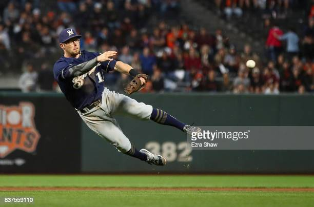 Eric Sogard of the Milwaukee Brewers tries unsuccessfully to throw Gorkys Hernandez of the San Francisco Giants out at first base in the second...