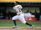 Eric Sogard of the Oakland Athletics bats against the Cleveland Indians during the game at Oco Coliseum on Wednesday April 2 2014 in Oakland...