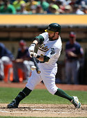 Eric Sogard of the Oakland Athletics bats against the Minnesota Twins during the game at Oco Coliseum on Sunday August 10 2014 in Oakland California