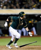 Eric Sogard of the Oakland Athletics bats against the Texas Rangers at Oco Coliseum on April 22 2014 in Oakland California