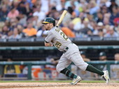 Eric Sogard of the Oakland Athletics bats during the fifth inning of the game against the Detroit Tigers at Comerica Park on June 30 2014 in Detroit...