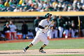 Eric Sogard of the Oakland Athletics bats during the game against the Houston Astros at Oco Coliseum on April 25 2015 in Oakland California The...