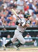 Eric Sogard of the Oakland Athletics bats during the second inning of the game against the Detroit Tigers at Comerica Park on June 30 2014 in Detroit...