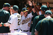 Eric Sogard of the Oakland Athletics celebrates after scoring on a double off the bat of Billy Burns of the Oakland Athletics in the sixth inning of...