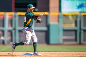 Eric Sogard of the Oakland Athletics defends his position during a spring training against the San Francisco Giants game at Scottsdale Stadium on...
