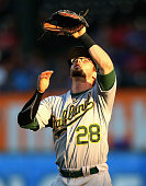 Eric Sogard of the Oakland Athletics field a play against the Texas Rangers in the first inning at Globe Life Park in Arlington on May 1 2015 in...