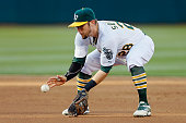 Eric Sogard of the Oakland Athletics fields a ground out against the Los Angeles Angels of Anaheim in the second inning at Oco Coliseum on June 19...