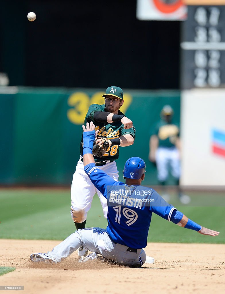 <a gi-track='captionPersonalityLinkClicked' href=/galleries/search?phrase=Eric+Sogard&family=editorial&specificpeople=6796459 ng-click='$event.stopPropagation()'>Eric Sogard</a> #28 of the Oakland Athletics gets his throw off to complete the double-play as Jose Bautista #19 of the Toronto Blue Jays slides into second base in the fifth inning at O.co Coliseum on July 31, 2013 in Oakland, California.