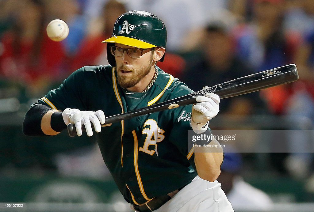<a gi-track='captionPersonalityLinkClicked' href=/galleries/search?phrase=Eric+Sogard&family=editorial&specificpeople=6796459 ng-click='$event.stopPropagation()'>Eric Sogard</a> #28 of the Oakland Athletics hits a bunt against the Texas Rangers in the top of the fifth inning at Globe Life Park in Arlington on September 25, 2014 in Arlington, Texas.