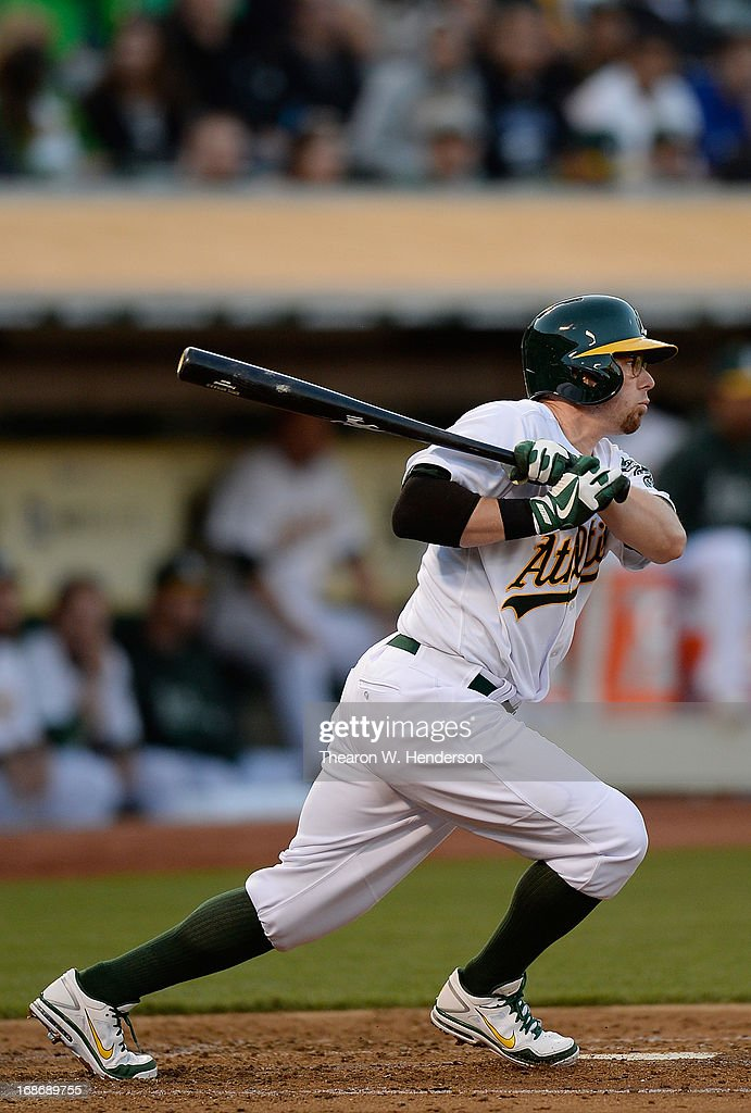 <a gi-track='captionPersonalityLinkClicked' href=/galleries/search?phrase=Eric+Sogard&family=editorial&specificpeople=6796459 ng-click='$event.stopPropagation()'>Eric Sogard</a> #28 of the Oakland Athletics hits an RBI single scoring Daric Barton #10 against the Texas Rangers in the second inning at O.co Coliseum on May 13, 2013 in Oakland, California.