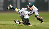 Eric Sogard of the Oakland Athletics is unable to field a ball hit by Brock Holt of the Boston Red Sox which scored a run in the fifth inning at...