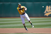 Eric Sogard of the Oakland Athletics makes an off balance throw to first base to get Alcides Escobar of the Kansas City Royals in the top of the...