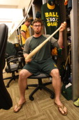 Eric Sogard of the Oakland Athletics relaxes in the clubhouse prior to the game against the Texas Rangers at Oco Coliseum on September 2 2013 in...