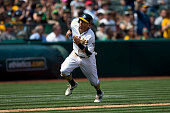 Eric Sogard of the Oakland Athletics rounds third base to score a run against the Texas Rangers during the eighth inning at Oco Coliseum on April 9...