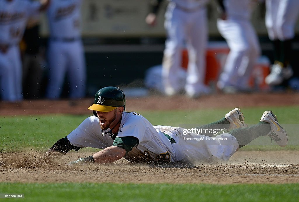 <a gi-track='captionPersonalityLinkClicked' href=/galleries/search?phrase=Eric+Sogard&family=editorial&specificpeople=6796459 ng-click='$event.stopPropagation()'>Eric Sogard</a> #28 of the Oakland Athletics scores the winning run on a throwing error from Manny Machado #13 of the Baltimore Orioles in the 10th inning at O.co Coliseum on April 28, 2013 in Oakland, California. The Athletics won the game 9-8.