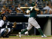Eric Sogard of the Oakland Athletics takes a swing in the third inning as John Ryan Murphy of the New York Yankees defends on June 3 2014 at Yankee...