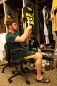 Eric Sogard of the Oakland Athletics tapes his bat up in the clubhouse prior to the game against the Chicago White Sox at Oco Coliseum on June 1 2013...